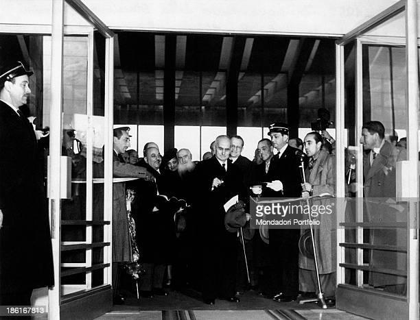 President of the Italian Republic Luigi Einaudi cutting the inaugural tape at Termini railway station The wife of Luigi Einaudi Ida Pellegrini...