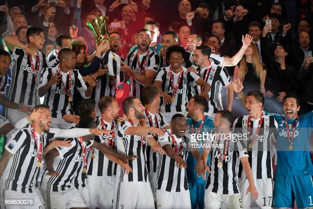 President of the Italian Senate Maria Elisabetta Alberti Casellati gives the trophy to Juventus' players after they won the Italian Tim Cup final...