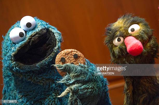 President of the Jim Henson Foundation Cheryl Henson Muppets Cookie Monster and Grover during a presentation a new of 20 Jim Henson puppets and props...