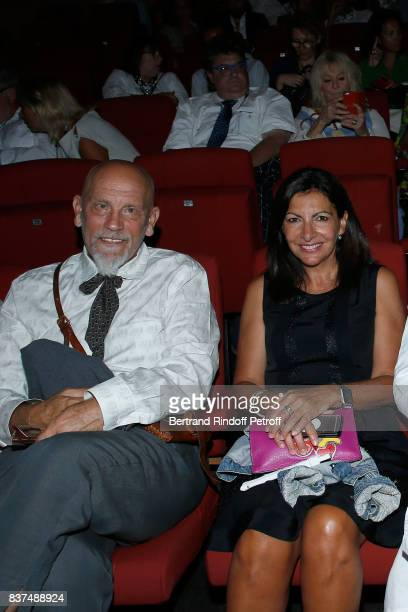 President of the Jury actor John Malkovich and Mayor of Paris Anne Hidalgo attend the 10th Angouleme FrenchSpeaking Film Festival Opening Ceremony on...