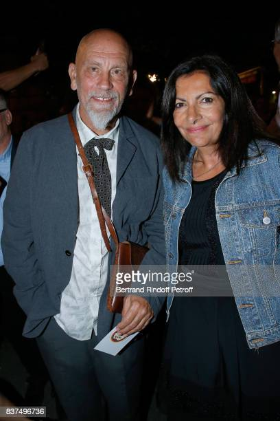 President of the Jury actor John Malkovich and Mayor of Paris Anne Hidalgo attend the 10th Angouleme FrenchSpeaking Film Festival Dinner after the...