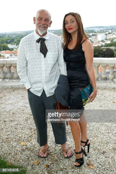 President of the Jury actor John Malkovich and Princess Isabella Orsini attend the 10th Angouleme FrenchSpeaking Film Festival Day One on August 22...