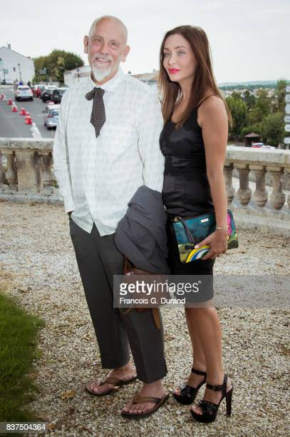 President of the Jury actor John Malkovich and Princess Isabella Orsini attend the Jury photocall during the 10th Angouleme FrenchSpeaking Film...