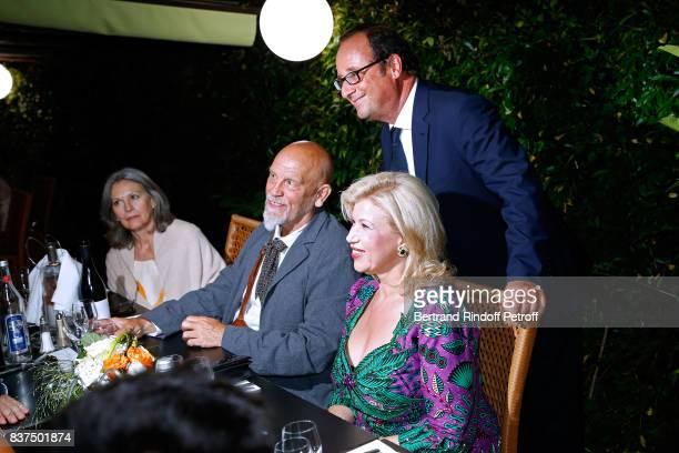 President of the Jury actor John Malkovich First lady of 'Cote d'Ivoire' Dominique Ouattara and former French President Francois Hollande attend the...