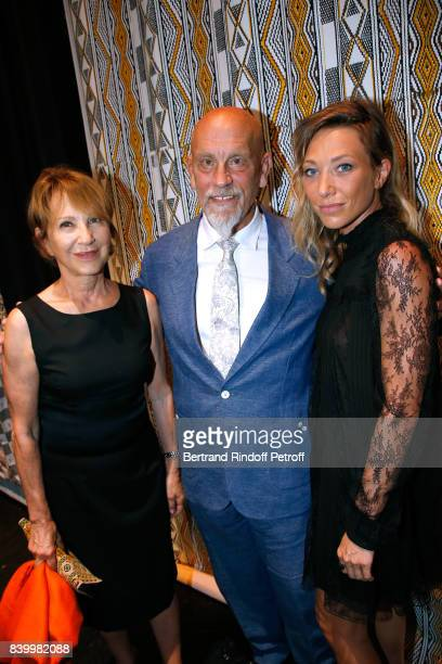 President of the Jury actor John Malkovich standing between Nathalie Baye and her daughter Laura Smet attend the 10th Angouleme FrenchSpeaking Film...