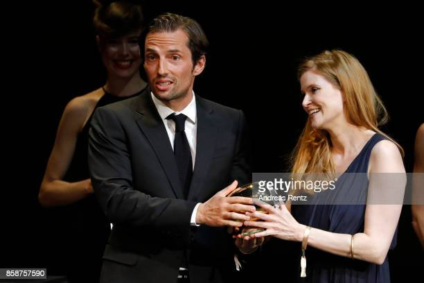 President of the jury for the focus on Switzerland Austria and Germany Quirin Berg hands over the award to Lisa Bruehlmann for her movie 'Blue My...