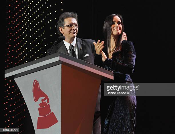 President of the Latin Recording Academy Gabriel Abaroa and singer Julieta Venegas speak onstage during the 2012 Person of the Year honoring Caetano...