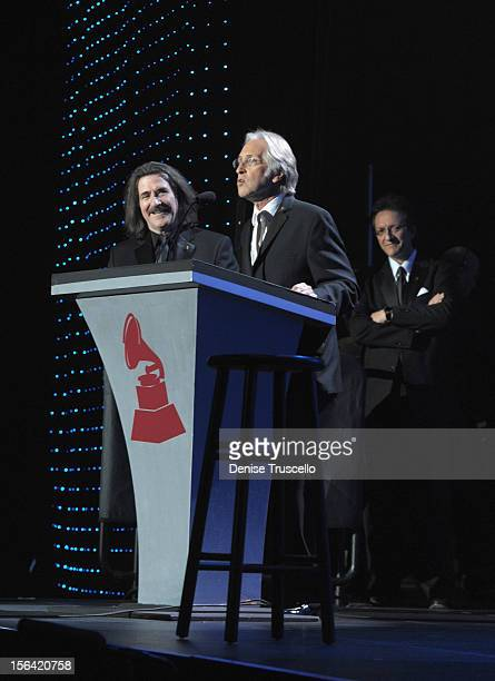 President of The Latin Recording Academy Luis Cobos and President of the National Academy of Recording Arts and Sciences Neil Portnow speak onstage...