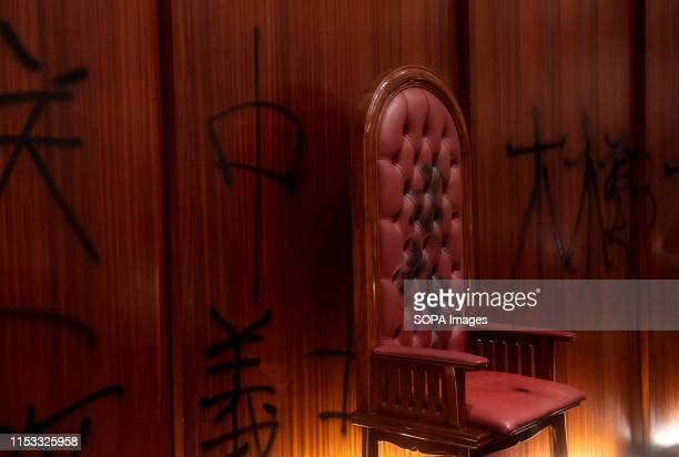 President of the Legislative Council seat defaced during the demonstration Hundreds of antigovernment protesters stormed into the legislative council...