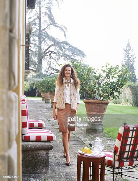 President of the Lungarno Collection Leonardo Ferragamo's wife Maria Beatrice is photographed in the gardent of their villa for Elle Decor in 2005 in...