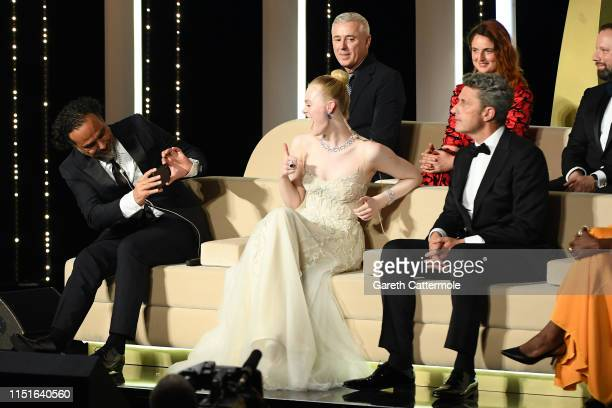 President of the Main competition jury Alejandro Gonzalez Inarritu takes a photo of Jury Member Elle Fanning at the Closing Ceremony during the 72nd...