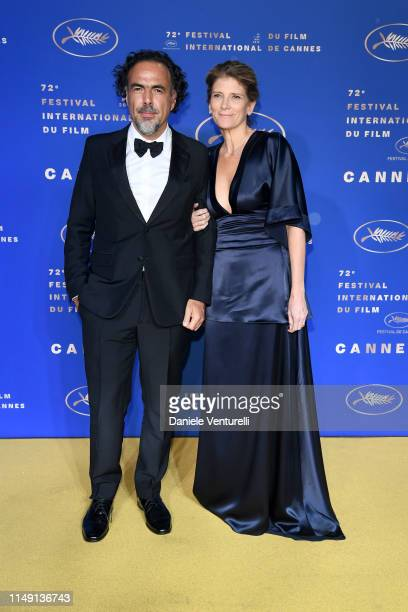 President of the Main competition jury Alejandro Gonzalez Inarritu and his spouse Maria Eladia Hagerman arriving at the Gala Dinner during the 72nd...