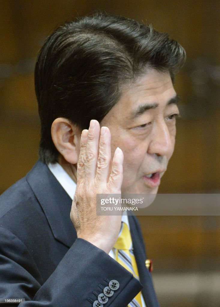 President of the main oppositon Liberal Democratic Party (LDP) Shinzo Abe gestures during a one-by-one debate with Japanese Prime Minister Yoshihiko Noda at the lower house on November 14, 2012. Prime Minister Noda said November 14 he will dissolve parliament on November 16 to hold an election if his opponents play ball on reforming the electoral system. AFP PHOTO/Toru YAMANAKA