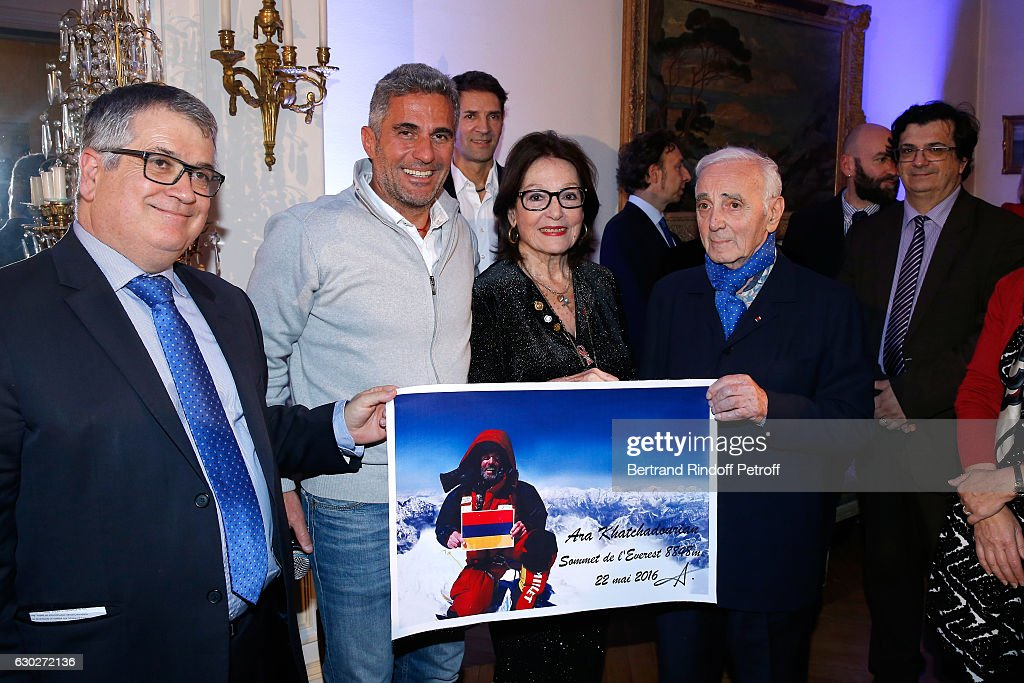 President of the 'Mediterranean Literature Center' Andre Bonet, Ara Khatchadourian, Bernard Thomasson, Nana Mouskouri, Stephane Bern, Charles Aznavour and guests attend Nana Mouskouri gives the Greek Prize 'Nikos Gatsos 2016' to Charles Aznavour at Embassy of Greece on December 19, 2016 in Paris, France.