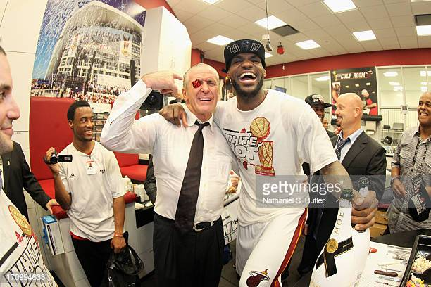 President of the Miami Heat Pat Riley celebrates with LeBron James of the Miami Heat and his good luck Nike sneaker eyelet after defeating the San...