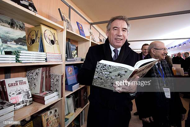 President of the MoDem centrist party and candidate for 2012 French presidential election Francois Bayrou looks at a cartoon entitled 'Gaza 1956' by...