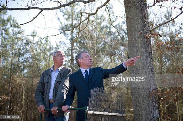 President of the MoDem centrist party and candidate for 2012 French presidential election Francois Bayrou talks to a logger during a campaign visit...