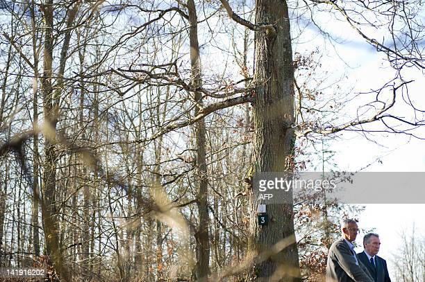President of the MoDem centrist party and candidate for 2012 French presidential election Francois Bayrou listens to explanations by a logger during...