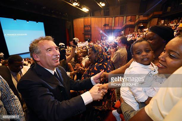 President of the MoDem centrist party and candidate for the 2012 French presidential election François Bayrou salutes supporters during a meeting on...
