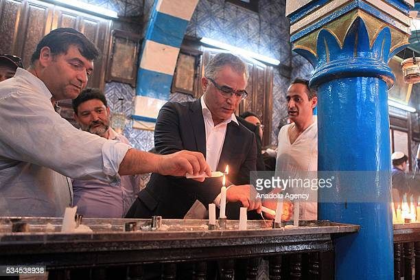 President of the Movement of Tunisias Project Mohsen Marzouk lights a candle as Jews from different countries visit Synagogue La ghriba to celebrate...