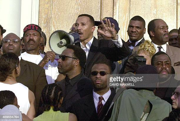President of the NAACP , Kweisi Mfume, speaks to a crowd assembled on the steps of the New Friendship Baptist Church in Cincinnati, OH, calling for...