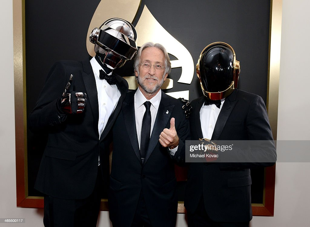 President of the National Academy of Recording Arts and Sciences Neil Portnow (C) and musical group Daft Punk attend the 56th GRAMMY Awards at Staples Center on January 26, 2014 in Los Angeles, California.