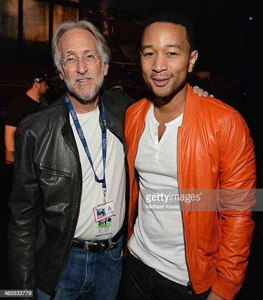 President of the National Academy of Recording Arts and Sciences Neil Portnow and singersongwriter John Legend attend The Night That Changed America...