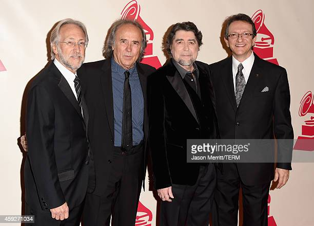 President of the National Academy of Recording Arts Sciences Neil Portnow honoree Joan Manuel Serrat singer Joaquin Sabina and CEO of the Latin...