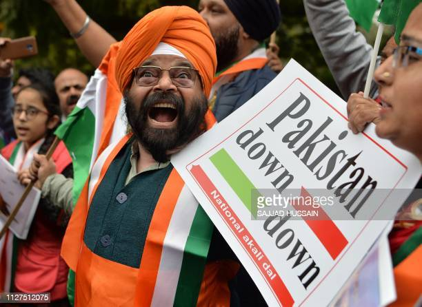 TOPSHOT President of the National Akali Dal party Paramjeet Singh Pamma holds a placard while shouting antiPakistan slogans with with party activists...