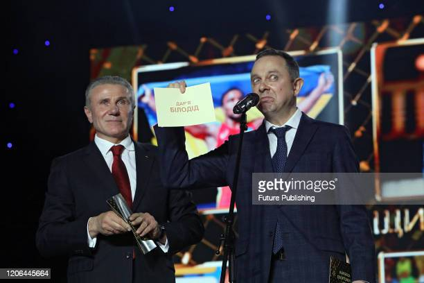 KYIV UKRAINE MARCH 9 2020 President of the National Olympic Committee Sergey Bubka and Minister of Youth and Sports of Ukraine Vadym Huttsait...