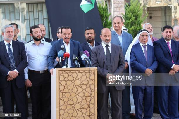 President of the National Reform Coalition Abdullah Al Akayilah makes a speech as officials Jordan's Islamic Action Front , the political party of...