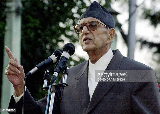 President of the Nepali Congress Girija Prasad Koirala addresses an antimonarchy gathering at the Ratna Park near the Royal Palace in Kathmandu 26...