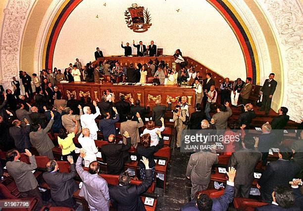 President of the new Venezuelan National Assembly William Lara takes the oath of office in Caracas 14 August 2000 along with the new 165member...