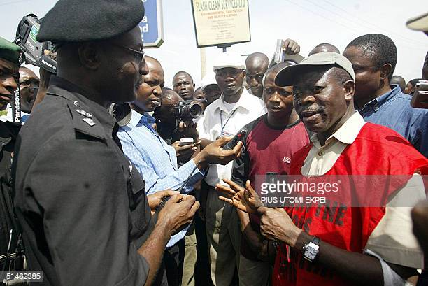 President of the Nigeria Labour Congress Adams Oshiomhole argue with police on the road leading to the Labour office 11 October 2004 during a protest...
