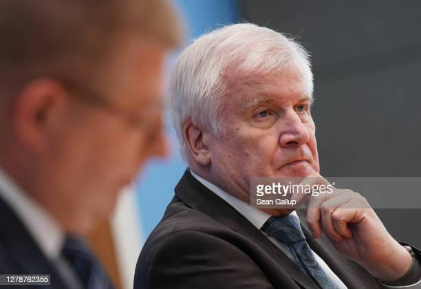 President of the Office for the Protection of the Constitution Thomas Haldenwang and Interior Minister Horst Seehofer speak to the media to present a...