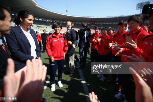President of the organizing committe for the FIFA women's World Cup 2011 Steffi Jones talks with North Korea Women¯s National Team players at Kim Il...