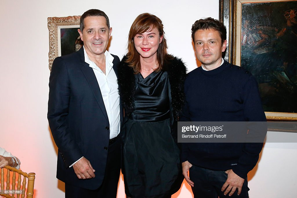 President of the Palais de Tokyo Jean de Loisy, his wife and contemporary artist Jean-Michel Othoniel attend the 'Diner des Amis du Musee d'Art Moderne' at Musee d'Art Moderne on October 21, 2014 in Paris, France.