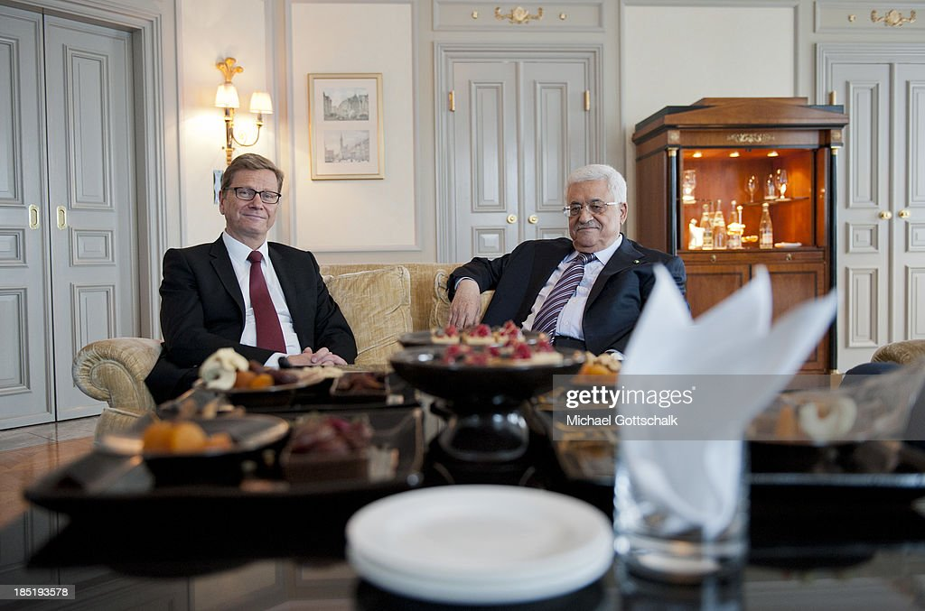 President of the Palestinian National Authority Mahmoud Abbas (R) and German Foreign Minister Guido Westerwelle (FDP) meet for a bilateral talk on October 18, 2013 in Hotel Adlon in Berlin, Germany. Abbas is currently in Europe partly to lobby the European Union against providing Israel funds for housing expansion in occupied territories.