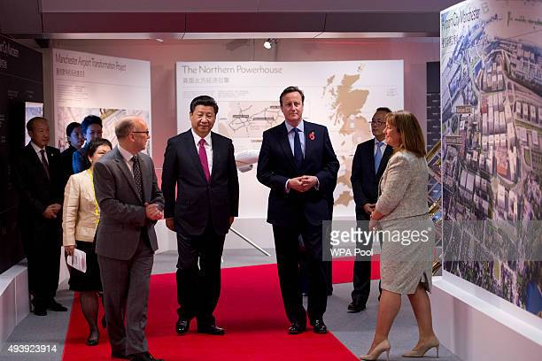 President of the People's Republic of China Xi Jinping and British Prime Minister David Cameron accompanied by the Chief Executive of The Manchester...