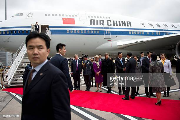 President of the People's Republic of China Xi Jinping and his wife Peng Liyuan greet dignitaries before boarding an Air China plane at Manchester...