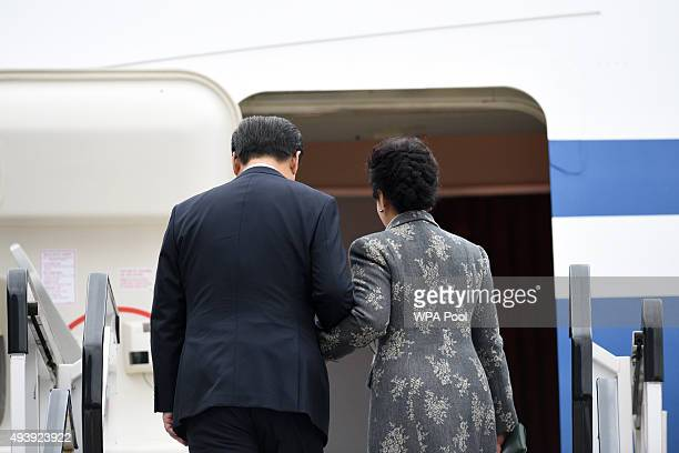 President of the People's Republic of China Xi Jinping and his wife Peng Liyuan board an Air China plane at Manchester airport at the end of their...