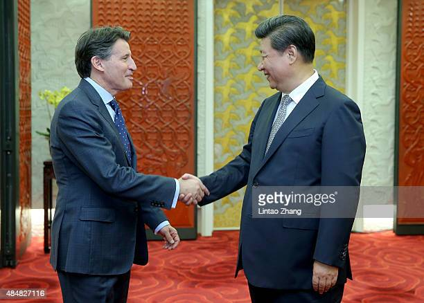 President of the People's Republic of China Xi Jinping greets newly elected IAAF president Sebastian Coe during the Opening Ceremony for the 15th...