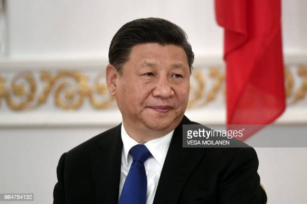 President of the People's Republic of China Xi Jinping looks on during a signing ceremony at the Presidential Palace in Helsinki on April 5 2017 /...