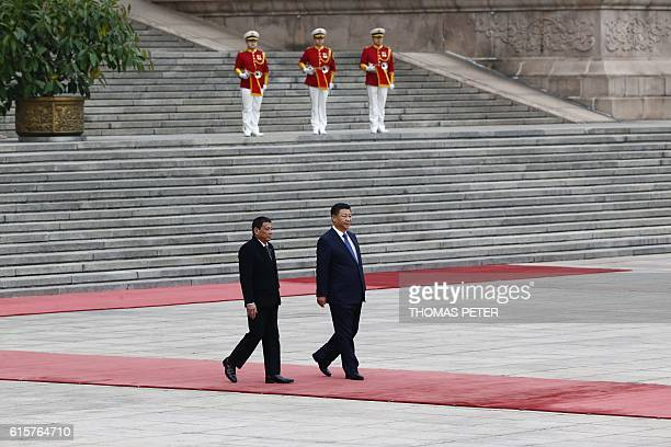 President of the Philippines Rodrigo Duterte and Chinese President Xi Jinping attend a welcoming ceremony at the Great Hall of the People in Beijing...