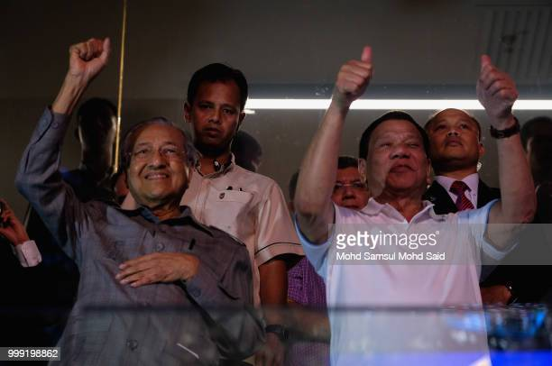 President of the Philippines Rodrigo Duterte with Malaysia's prime minister Mahathir Mohamed show thumbs up to Philippine's Manny Pacquiao after...