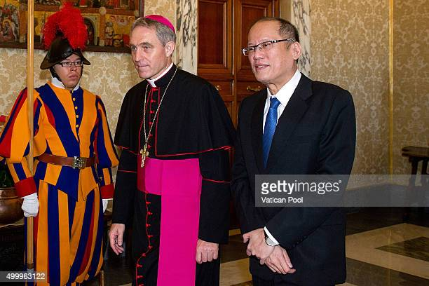 President of the PhilippinesÊBenigno S Aquino III flanked by Prefect of the Pontifical House Georg Ganswein arrives at the Apostolic Palace for a...