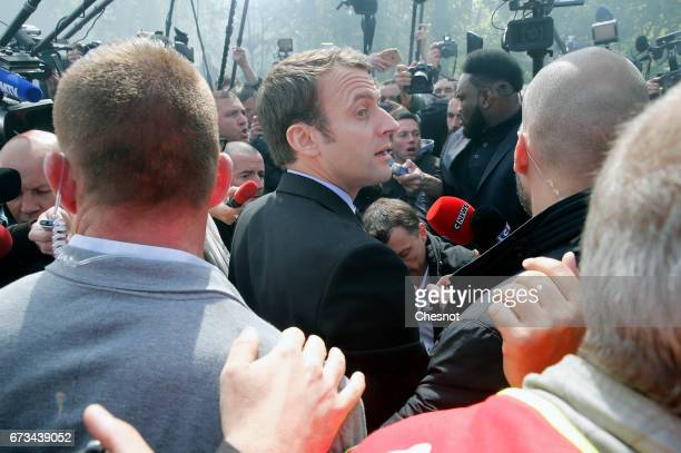 President of the political movement 'En Marche ' and French presidential election candidate Emmanuel Macron meets strike employees of Whirlpool on...