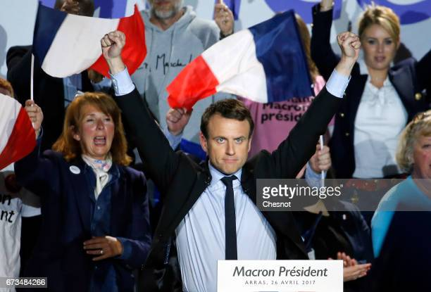 President of the political movement 'En Marche !' and French presidential election candidate Emmanuel Macron gestures at the end of his campaign...