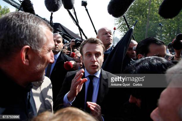 """President of the political movement 'En Marche"""" and French presidential election candidate Emmanuel Macron meets strike employees of Whirlpool on..."""