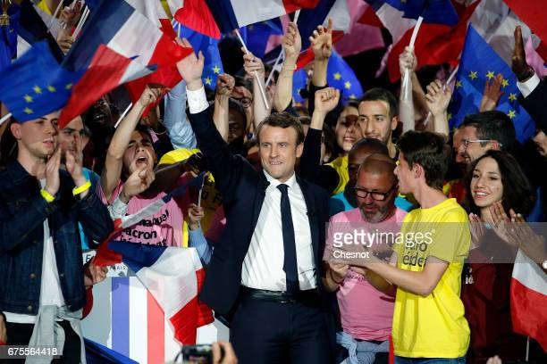 President of the political movement 'En Marche ' and French presidential election candidate Emmanuel Macron waves during a campaign rally on May 01...